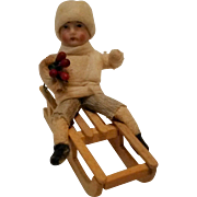 SOLD Antique Christmas ornament Heubach Germany cotton bisque face  boy on sled holly