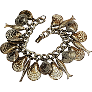Puffy charm bracelet shells and fish white wash on gold tone