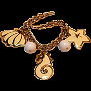 Napier charm bracelet enamel seahorse shell starfish