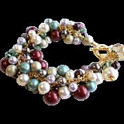 SOLD Swarovski Faux Pearl and Crystal Charm Bracelet