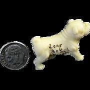 1920's Tiny Molded Plastic Dog Figurine Souvenir of Long Beach WA