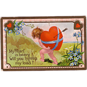 "Valentine Postcard "" Nude Cupid Carrying Heart on his Back """