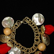 Vintage Gold Tone Bracelet with Bakelite and Mother of Pearl Charms