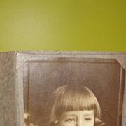 Sleepy Little Girl in Brass Photo Frame