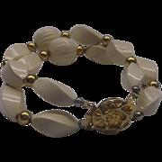 Cream Twisted Bead Bracelet Gold Tone Knot Clasp