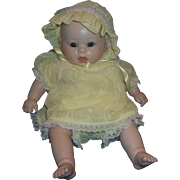 Bisque Porcelain Baby Doll Yellow Dress Bloomers Bonnet Brown Glass Eyes Hand Painted Face 12