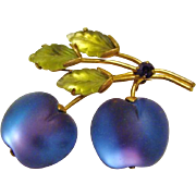 circa 1950: Plumlucsious  Austria Frosted Fruit Brooch