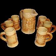 "Hull Stoneware Pottery ""Old Tavern"" Pitcher and 6 Mugs"