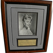 Actress and singer DORIS DAY autograph 1950 nicely framed signed canceled check to publicity .