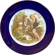 """Rosenthal Germany Figural cabinet plate """"Melon Eaters"""" with a cobalt blue border and gilde"""