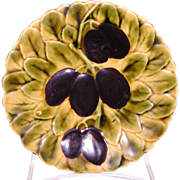 Sarreguemines French majolica plate decorated with purple plums