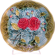 Antique Belgian Wasmuël majolica plate with red roses and rose buds on a turquoise background
