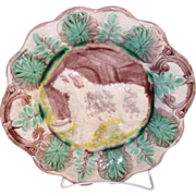 Wonderful old large Majolica pottery plate with the central design of a dog and his ...