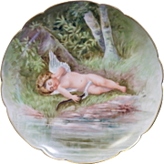 Fantastic Haviland Limoges hand painted scalloped edge plate with Cupid lying near a stream in