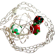 """REDUCED Reduced Beautiful lamp work beads swirled in a silver wire.  On a silver chain. 25"""""""