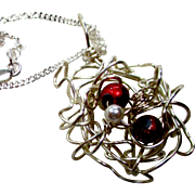 REDUCED Artisan necklace, Silver wire in a nest cloud.  Two red glass beads and a ...