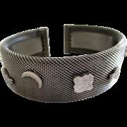 SALE Silver tone mesh cuff bracelet.  Nine charms, vintage 60s-70s.
