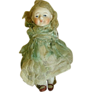 Antique all bisque closed mouth doll