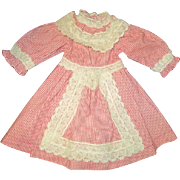 A wonderful vintage doll dress