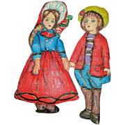 A. Marquee  rendition cloth sculpted  and painted one of  a kind dolls