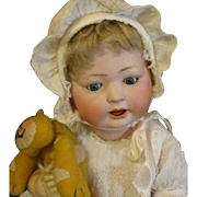 Charming antique baby doll