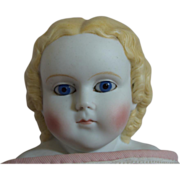 SOLD Early German Bisque Head Doll with Riveting Blue Glass Eyes
