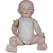 Large German All Bisque Baby with Molded Gown