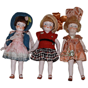 Three All Bisque German Dolls in Original Costumes