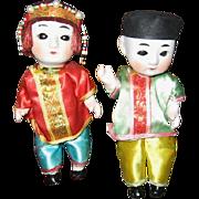 Pair of Oriental Bisque Head Squeak Dolls
