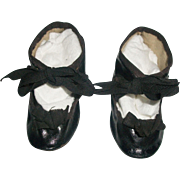Pair of Early Vintage Black Oil Cloth Doll Shoes