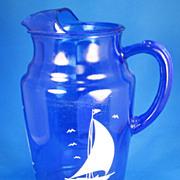 SALE PENDING 1930s Depression Glass Cobalt Blue Hazel Atlas Sailboat Patterned Pitcher and Gla