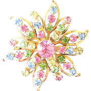 Rhinestone Star burst pin with Pink Green Yellow and blue stones gold toned