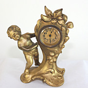 Charming antique mantel clock with putti and flowers