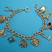Vintage Sterling Silver Mixed Charm Bracelet
