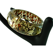 Fabulously Wonderful Golden Swirl Reverse Carved Lucite Bangle