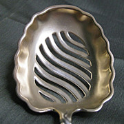 Sterling Silver Slotted Pea Server in the Twisted Oval Pattern by Whiting