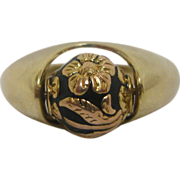 14 K Gold Ring with a Floral Motif Enameled Center Rolling Ball