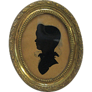 Silhouette Portrait of Young Boy in Original Frame