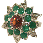 18 K White and Yellow Gold Starburst Ring with Spessartite Garnet, Emeralds, and Diamonds