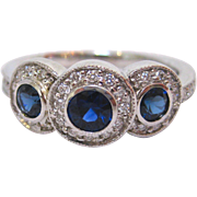 3 Stone Sapphire Ring with Diamonds in 18 K White Gold