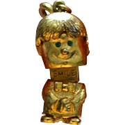 SALE 1960s MONET Mechanical 'SMILE' Boy w/ Green Rhinestone Eyes Movable 3D Charm