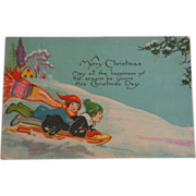 SALE Christmas Postcard Children Sledding 1928