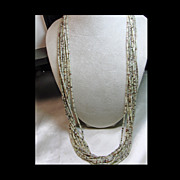 Vintage 10 Strand  Necklace of Very Fine Shell Heishi with Silver Tips
