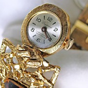Clamper Style Costume Jewelry Bracelet with Hidden Watch