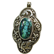 Tibetan Turquoise Pendant with Sterling Silver Repousse Decoration