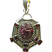 Sterling Silver Pendant with Carved Oval Garnet and Emerald Cut Garnet Accent Stones