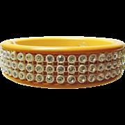 1940s' Deep Egg Yolk Mustard Bakelite Bangle Bracelet with White Crystal Rhinestones