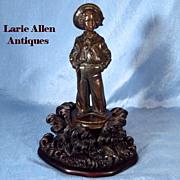 SOLD Reserved for K   Antique French bronze sailor boy on carved black forest base