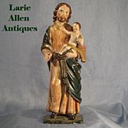 SOLD Antique St. Joseph Infant Christ Handcarved Santos