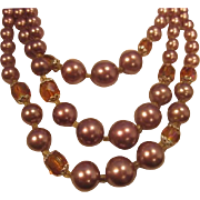 Vintage Triple Strand Bead Necklace with graduating Soft Purple Faux Pearls and Aurora Boreali